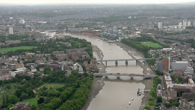 Aerial shots sweeping over central London approaching central London from Roehampton with Londons highest bdgs seen from a distance following The...