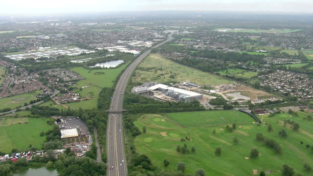 Aerial shots sweeping over the dual fourlane M25 motorway following the M3 from Laleham Park to Kempton Park Racecourse in England on Monday 7th...