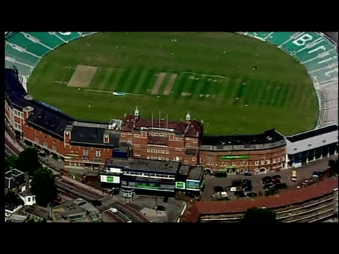 aerial shots the brit oval cricket ground with anon cricketers training on pitch - oval kennington stock videos & royalty-free footage