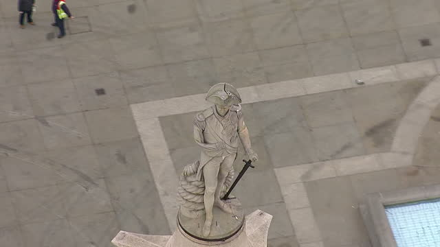 aerial shots tourists in trafalgar square includes close up shot of admiral horatio nelson standing atop nelson's column aerial shots trafalgar... - admiral nelson stock videos and b-roll footage