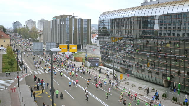 Aerial showing large number of runners running the urban marathon