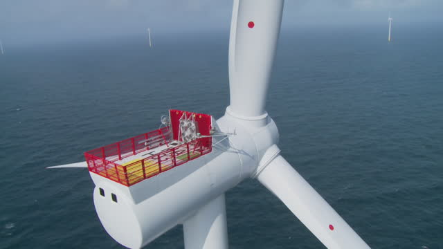 aerial showing platform at top of offshore wind turbine - horizon over water stock videos & royalty-free footage