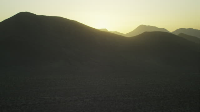 Aerial Side POV Hilly Desert Sunset