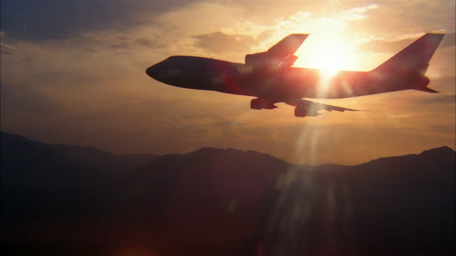 aerial silhouette of airplane with sunset in background - side view stock videos & royalty-free footage