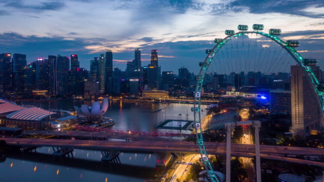 aerial singapore city view at dusk - marina bay sands stock videos and b-roll footage