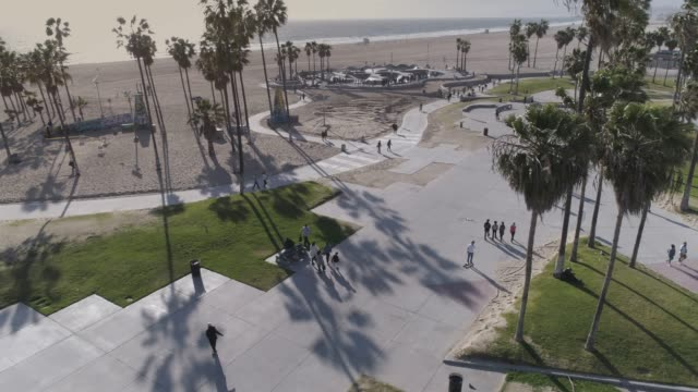 aerial skateboarders on venice beach boardwalk - venice california stock videos & royalty-free footage
