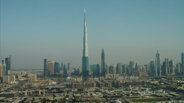 aerial skyline dubai downtown skyscrapers burj khalifa uae - international landmark stock videos & royalty-free footage