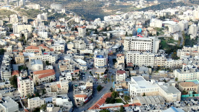 aerial / skyline of ramallah with traffic seen from above - islam stock videos & royalty-free footage