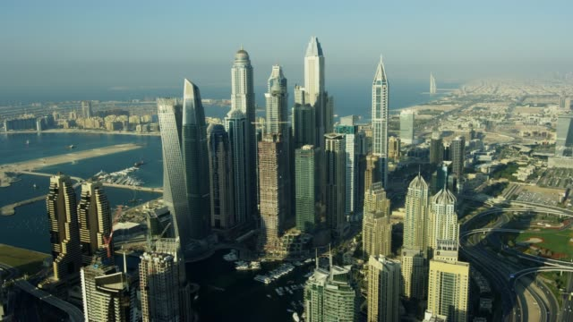 aerial skyline view of city skyscrapers dubai uae - dubai stock videos & royalty-free footage