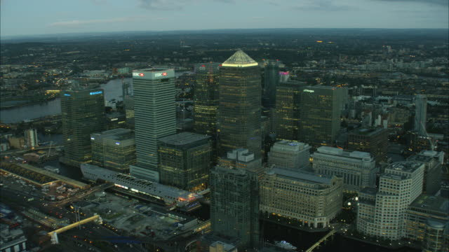 aerial skyscraper cityscape night view of london uk - canary wharf stock videos & royalty-free footage