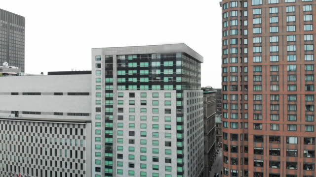 stockvideo's en b-roll-footage met aerial: skyscrapers in a city - gevel