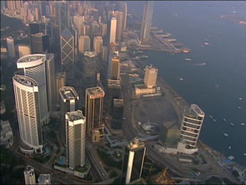 2002 aerial skyscrapers near victoria harbour/ hong kong - bank of china tower hong kong stock videos and b-roll footage
