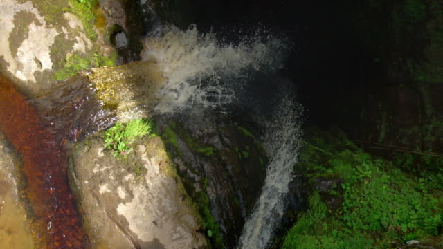 aerial slow motion view of the stream fell beck falling into gaping gill - cave stock videos & royalty-free footage