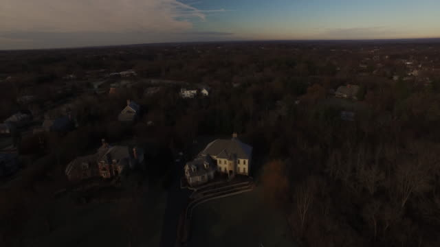 Aerial slowly flying over a wealthy neighborhood on a fall afternoon