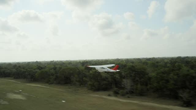 aerial small plane takes off - propeller bildbanksvideor och videomaterial från bakom kulisserna