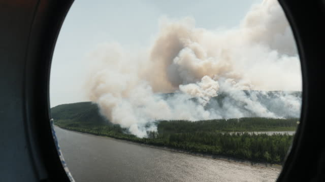 aerial smoke from forest fires, filmed from helicopter, in yakutia region of siberia, along the arctic circle, releasing record amounts of greenhouse... - russia stock videos & royalty-free footage