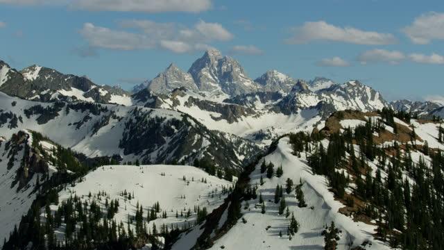 aerial snow covered mount moran teton mountains usa - mt moran stock videos & royalty-free footage