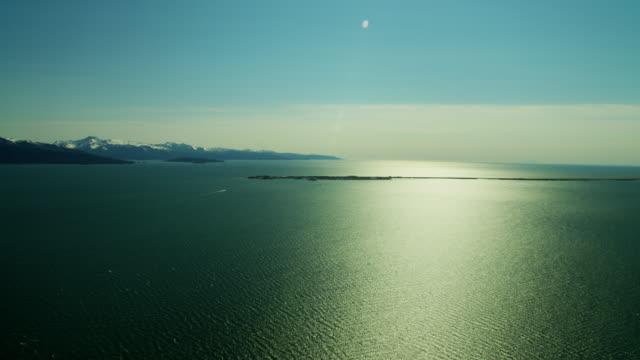 vídeos de stock e filmes b-roll de aerial snow covered mountains kachemak bay alaska - eco tourism