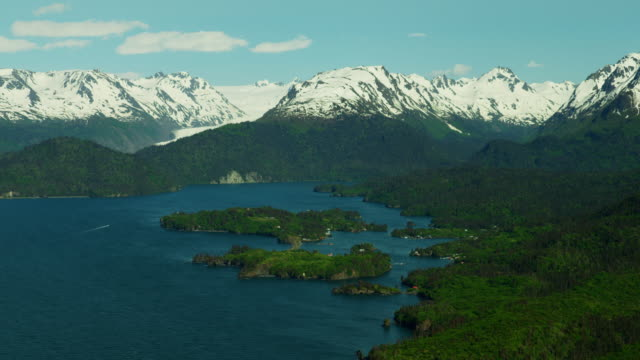vídeos de stock, filmes e b-roll de aerial snow covered mountains kachemak bay alaska - eco tourism