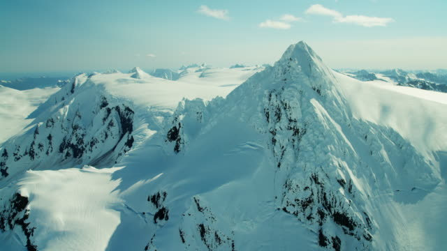 Aerial snow covered mountains Kachemak Bay Alaska