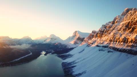 aerial snow mountain at sunrise - mountain peak stock videos & royalty-free footage