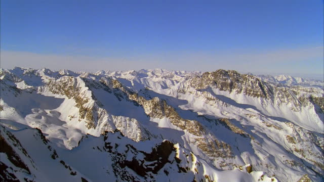aerial snow-covered peaks of mountains in alps / switzerland - european alps stock videos & royalty-free footage