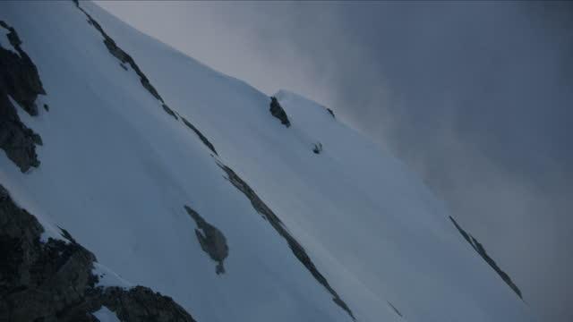 aerial snowy slopes mt moran summit yellowstone usa - mt moran stock videos & royalty-free footage