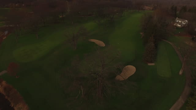 Aerial soaring over golf course with 360 degree rotation