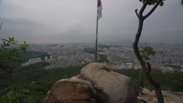 aerial, south korean flag overlooks city - south korean flag stock videos & royalty-free footage