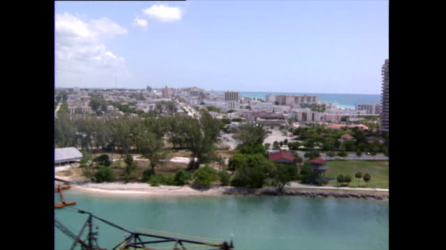 aerial ts of south pointe shoreline; miami, 1992 - yacht stock videos & royalty-free footage