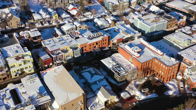 aerial spin above residential neighborhood in a snowy mountain ski town with quiet streets and bright morning sunlight - park city, utah - park city stock videos & royalty-free footage