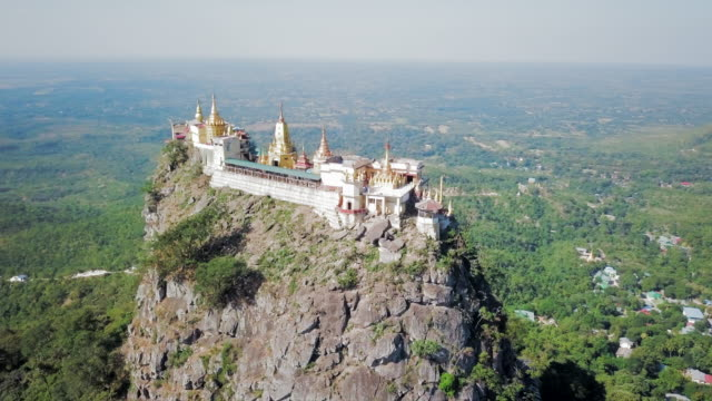 aerial spin: close view all around the popa taungkalat temple - myanmar stock-videos und b-roll-filmmaterial
