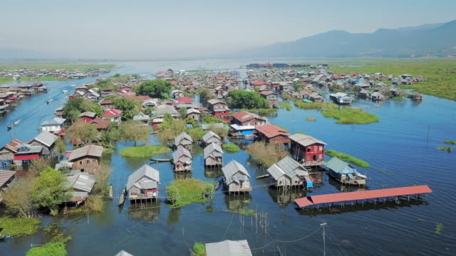 aerial spin: homes on stilts on inle lake - stilts stock videos and b-roll footage