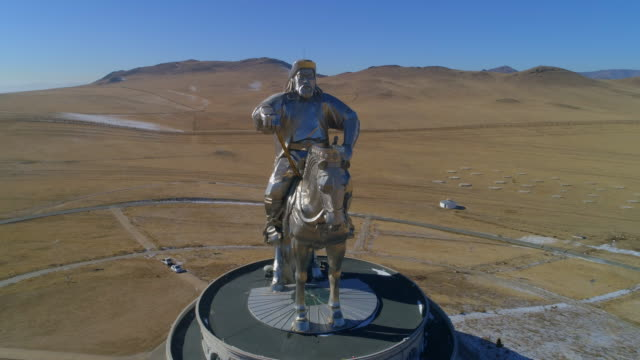 aerial spin: large statue of genghis kahn on the roof of a museum - ulaanbaatar, mongolia - ulan bator stock videos & royalty-free footage