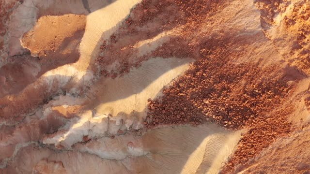 aerial spin: red rocks and sand in a desert canyon in negev desert, israel - israel stock-videos und b-roll-filmmaterial