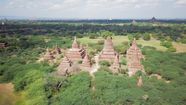 aerial spin: temple among the sacred land of old bagan - myanmar stock-videos und b-roll-filmmaterial