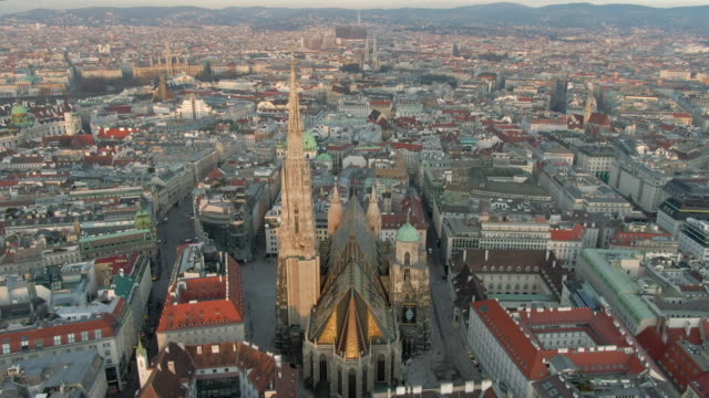 aerial: st. stephen's cathedral in vast vienna cityscape, in austria - dome stock videos & royalty-free footage