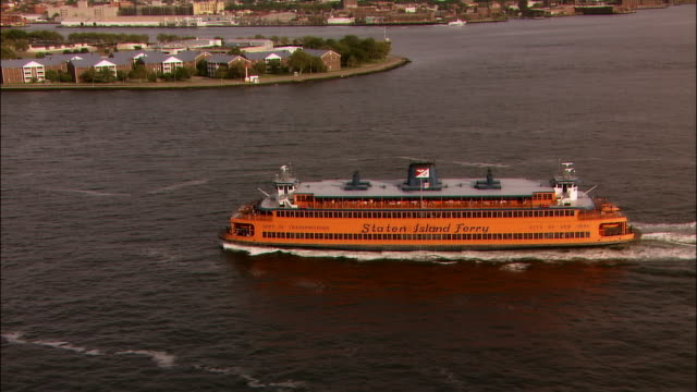 aerial staten island ferry in new york harbour/ new york city - new york harbor stock videos & royalty-free footage