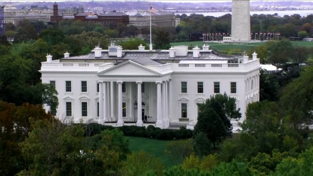 aerial steady shot of the white house in daylight - white house washington dc stock videos & royalty-free footage