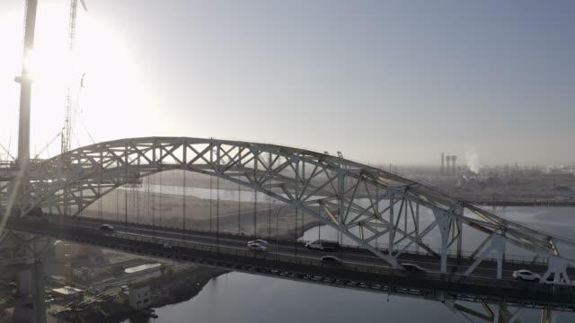 vídeos y material grabado en eventos de stock de aerial: steel bridge in port of los angeles with backdrop of cranes and la - san pedro, california - puerto de los angeles