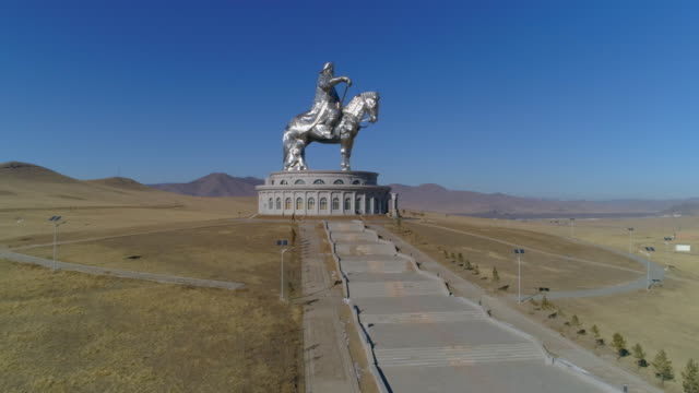 aerial: steps of a long walkway leading up to a genghis kahn statue - ulaanbaatar, mongolia - dictator stock videos & royalty-free footage
