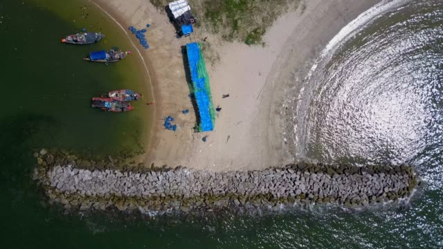 aerial. stone wave breaker into the sea at map ta phut industrail estate, rayong, thailand - pattaya stock videos & royalty-free footage