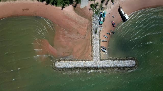 Aerial. Stone wave breaker into the sea at Pattaya, Chonburi, Thailand
