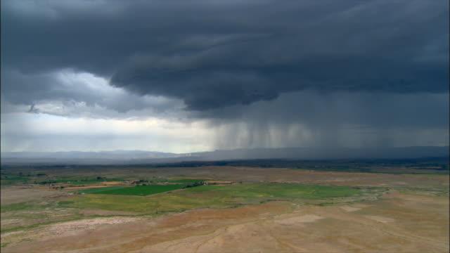 aerial storm cloud looming over plain / price, utah - cinematography stock videos & royalty-free footage