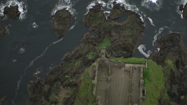 aerial straight down over ireland coastline castle ruins - castle stock videos & royalty-free footage