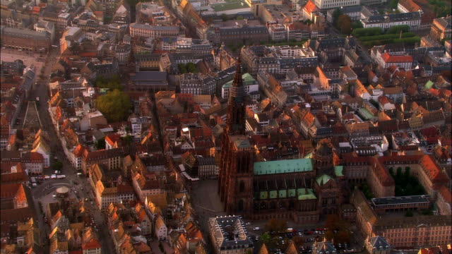aerial ws strasbourg cathedral and surrounding city / strasbourg, alsace, france - cathedral stock videos & royalty-free footage