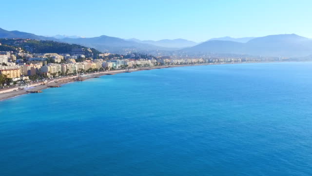 aerial: stunning high elevation pan shot of the french riviera along nice - 夏休み点の映像素材/bロール