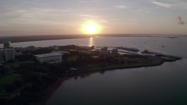 aerial: sun rises over the buildings in the city of darwin - northern territory australia stock videos & royalty-free footage