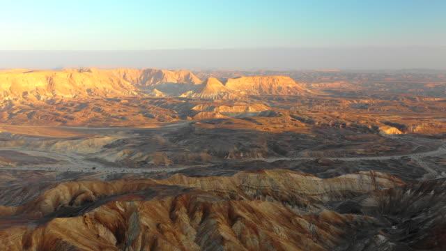 aerial: sun shining on the desert mountains in negev desert, israel - negev stock videos & royalty-free footage
