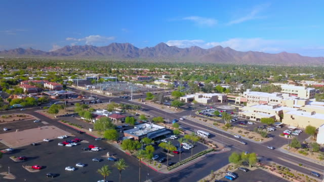 aerial: sun touching scottsdale arizona usa - arizona stock videos & royalty-free footage